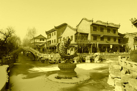 antique buildings and carp sculpture, closeup of photo