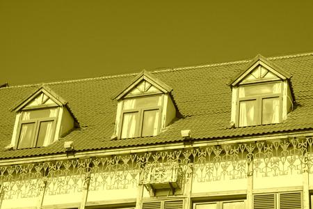 attic window: Loft exotic landscape architecture and small attic window under blue sky
