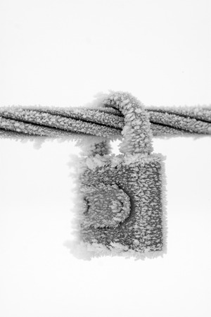 toughness: Wire rope and locks in the frost and snow, closeup of photo