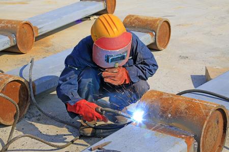 Welders in the construction site