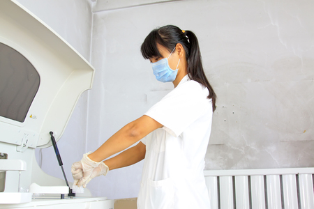 in vitro: Luannan county - September 21: doctor test using biochemical analyzer, luannan county, hebei province, China, on September 21, 2015.