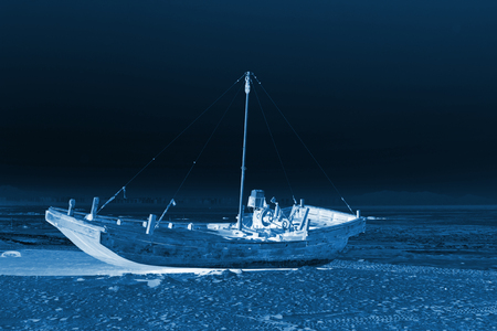 fishing boats by the sea in winter