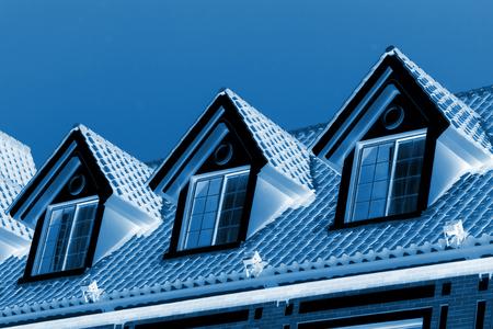Loft exotic landscape architecture and small attic window under blue sky
