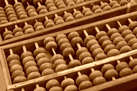 Chinese traditional calculator - abacus, closeup of photo