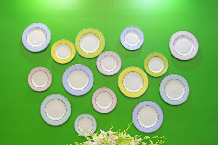 Ceramic plate in green background Editorial