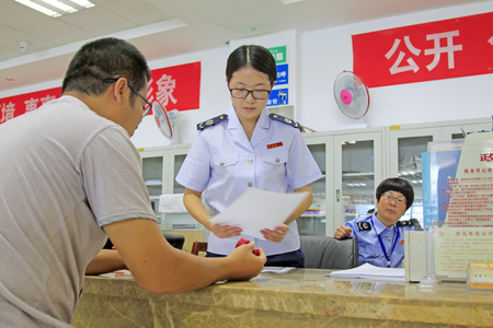 taxpayers: Luannan County- September 21: tax personnel service for taxpayer, luannan county, hebei province, China, on September 21, 2015. Editorial
