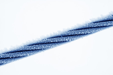 Wire rope in the frost and snow, closeup of photo