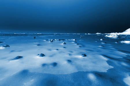 ice and snow natural landscape by the sea, closeup of photo