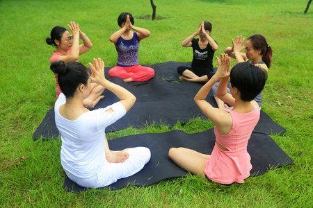 tangshan city: Tangshan - August 17: women doing yoga exercise in the park, August 17, 2016, tangshan city, hebei province, China