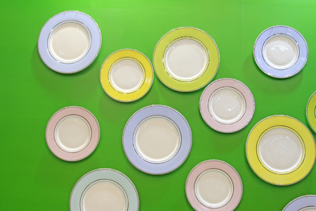 Ceramic plate in green background Stock Photo