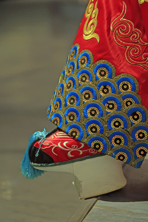 Peking Opera props embroidered shoes close up view