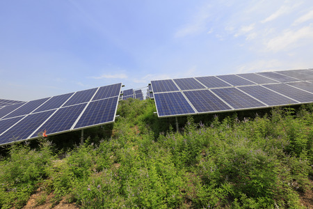 electric grid: solar panel on the hillside, closeup of photo Stock Photo