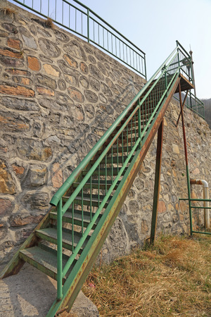 Steel stairs and rock walls