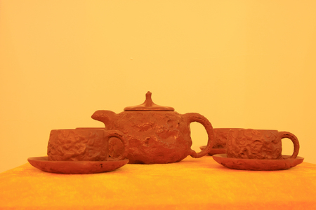 Violet sand earthenware clay teapot crafts Stock Photo