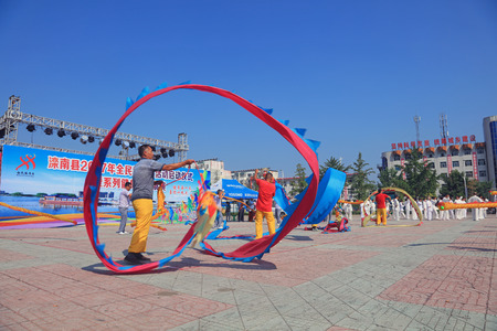 hebei: Luannan County - August 8, 2017:  coloured ribbon show in a park, Luannan County, Hebei Province, china.