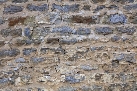 Cracked brick wall close up view