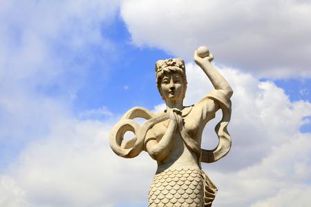 Mermaid sculpture in a garden