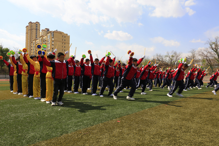 Luannan County - April 18, 2016: student group gymnastics training on the playground, in a middle school, Luannan County, Hebei Province, China