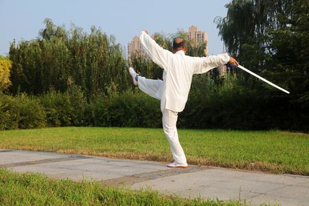 Luannan County - August 10, 2017: A Chinese martial artist practicing Taiji Sword in a park, Luannan County, Hebei Province, china.  Editorial