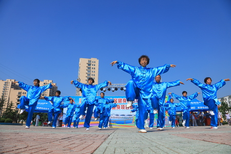 Luannan County - August 8, 2017:  body building exercise show in a park, Luannan County, Hebei Province, china.