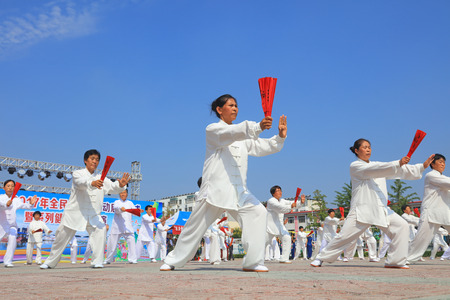 Luannan County - August 8, 2017: Taiji Kung Fu performance in a park, Luannan County, Hebei Province, china.