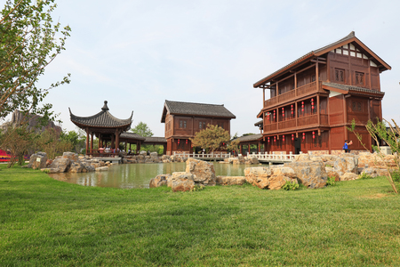 Chinese classical architecture in a park   Editorial