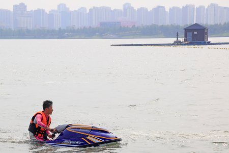 Tangshan - July 8, 2016: motorboat stunts on water, Tangshan City, Hebei, China