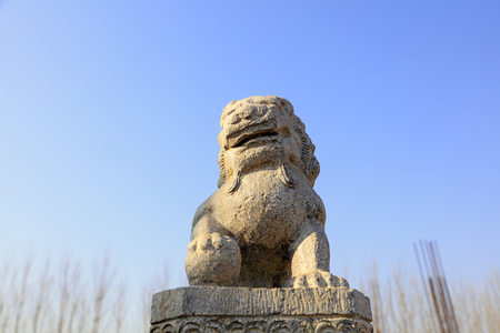 stone lion engraving in the blue sky