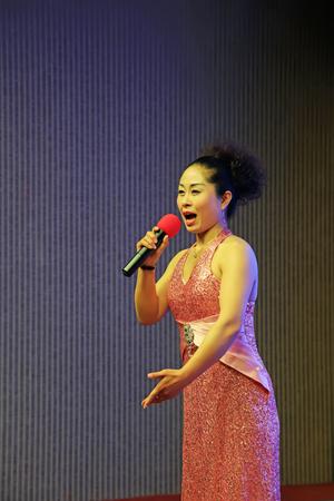 Beijing - May 20, 2016: woman singing Chinese traditional shadow play, Beijing, China