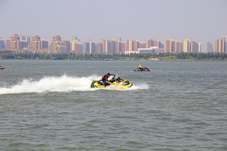 Tangshan - June 19, 2016: motorboat stunts on water, Tangshan City, Hebei, China Editorial