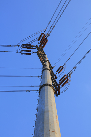 Electric steel poles in the blue sky background Imagens
