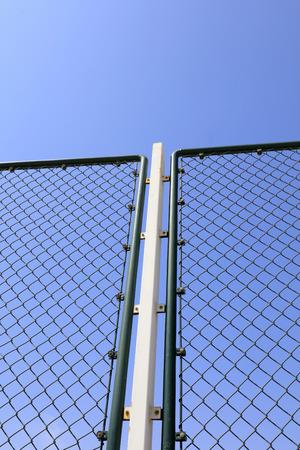 Metal protective net in blue sky background 版權商用圖片
