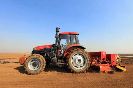 Luannan County - March 7, 2019: Rotary tillage seeder in operation, Luannan County, Hebei Province, China