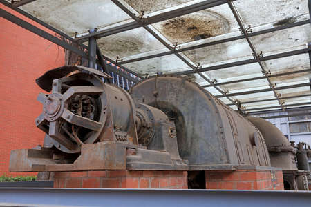 The rusty turbine generator lay idle in a corner of the factory