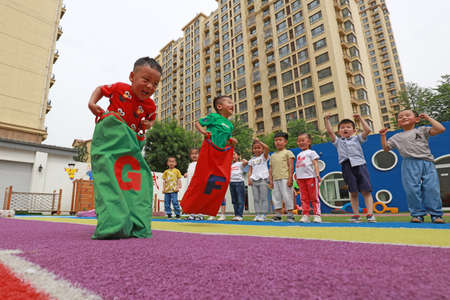 Luannan County-May 30, 2019: Kindergarten children play games to celebrate the upcoming 61 International Children's Day, Luannan County, Hebei Province, China