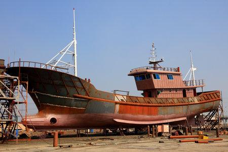 ship under construction in a shipyard