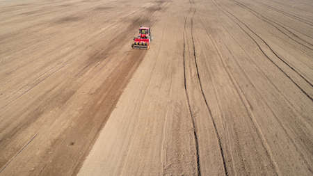 Rotary tiller planters grow peas on farms, Luannan County, Hebei Province, China