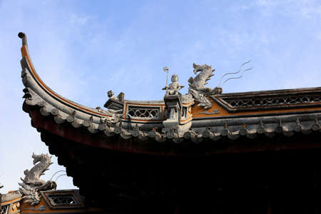 The sculpture on the roof ridge is in Chenxiang Pavilion, Shanghai, China
