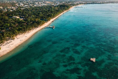On the beautiful beach of the island of Mauritius along the coast. Shooting from a bird's eye view of the island of Mauritius