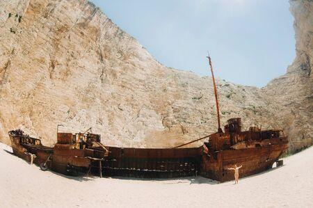 curved ship on Zakynthos island, Greece Navagio beach, or shipwreck beach,sometimes called smugglers ' Bay , on the coast of Zakynthos island, in the Ionian Islands of Greece
