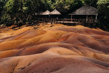 Seven colored earths in Mauritius, nature reserve, Chamarel. The green forest is behind us.Mauritius island. Stock Photo