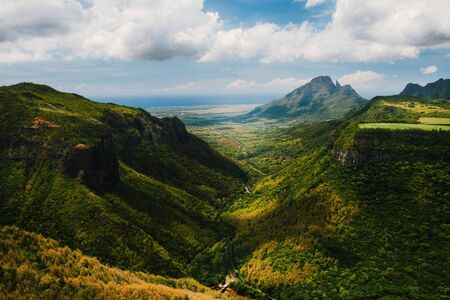 Mountain Landscape of the gorge on the island of Mauritius, Green mountains of the jungle of Mauritius