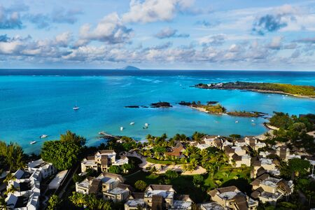 Aerial photography of a coral reef and a hotel complex with beaches in Mauritius, the North-East coast of the island of Mauritius. Beautiful lagoon of the island of Mauritius, taken from above.
