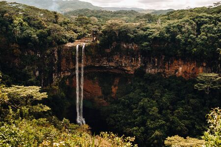 View from the observation deck of the Waterfall in the Chamarel nature Park in Mauritius. 스톡 콘텐츠 - 147256679