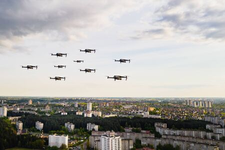 Drones flying over the houses of the city of Minsk. Urban landscape with drones flying over it.Quadrocopters fly over the city