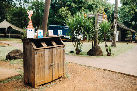 Wooden trash can for collecting separately plastic, cardboard and organic products in a Park on the island of Mauritius.