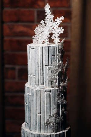 Amazing Cakes. chocolate wedding cake white Cake on a black background.Large cake in white chocolate.