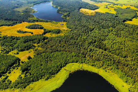 Top view of Bolta lake in the forest in the Braslav lakes National Park at dawn, the most beautiful places in Belarus. An island in the lake.