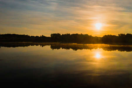 Top view of lake Drivyaty in the forest in the Braslav lakes National Park at sunset, the most beautiful places in the city of Belarus.An island in the lake. 版權商用圖片