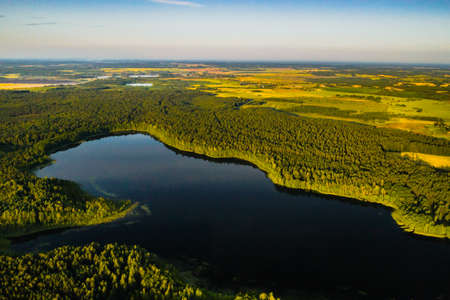 Top view of Bolta lake in the forest in the Braslav lakes National Park at dawn, the most beautiful places in Belarus.An island in the lake.Belarus.